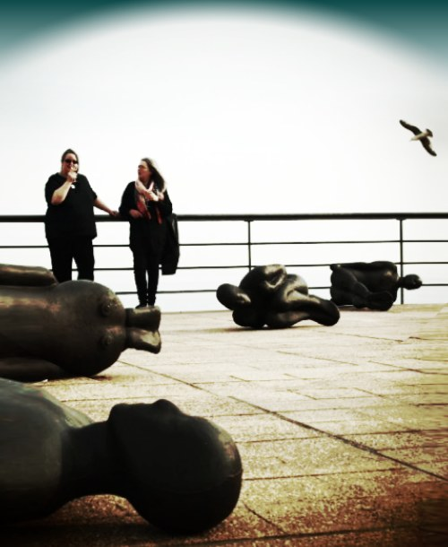 Gormley inspired art image - people in black on the DeLaWarr pavillion roof in Bexhill