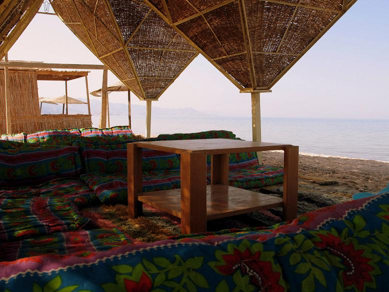 In the shade on the beach by the Red Sea?