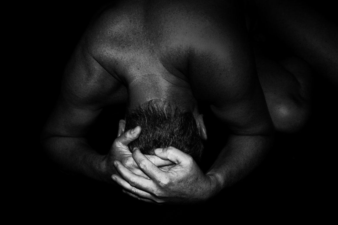 Black & White Photograph of a man in submission