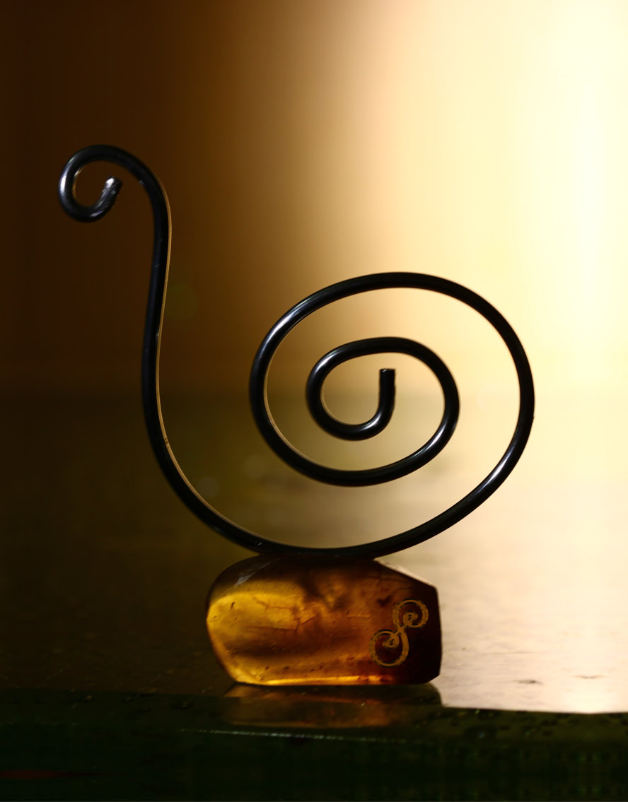 Snail sculpture aluminium mounted on amber