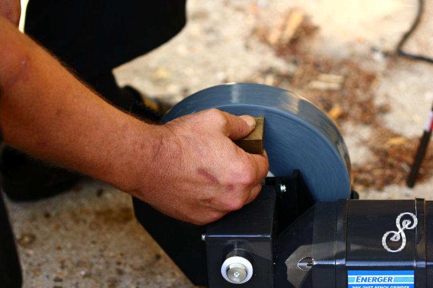 Hand grinding brass