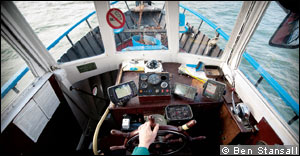 At the wheel of a fishing charter boat